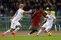 Roma's Gerson, center, is challenged by Bologna's  Filip Helander, left, and Cesar Falletti, during the Serie A football match between Roma and Bologna at Rome's Olympic stadium, October 28, 2017.<br /> UPDATE IMAGES PRESS/Riccardo De Luca