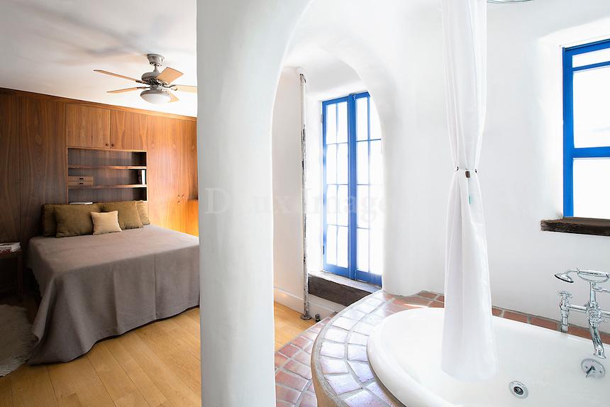 white bathtub in the bedroom