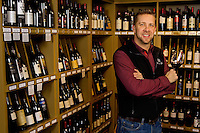 University Package - Owner of the Wine Vault Tim Wallace inside his store..Photo by: PatrickSchneiderPhoto.com