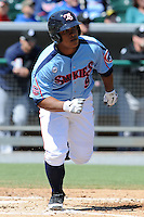 Tennessee Smokies catcher Juan Apodaca #9 runs to first during a game between the Jackson Generals and the Tennessee Smokies at Smokies Park, Kodak, Tennessee April 11, 2012. The Generals won 2-1  (Tony Farlow/Four Seam Images)..