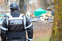 A member of the National Eviction Team looks on during a protest against the building of the HS2 railway line at Euston Square Gardens on 27th January 2021