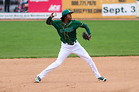 Beloit Snappers shortstop Eric Marinez (2) throws to first base during a Midwest League game against the Peoria Chiefs on April 15, 2017 at Pohlman Field in Beloit, Wisconsin.  Beloit defeated Peoria 12-0. (Brad Krause/Four Seam Images)