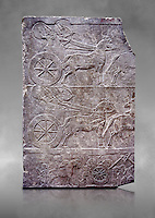 Stone relief sculptured panel of aa Assyrian Chariot. From the palace of Assurbanipal room VI/T1, Nimrud, third quarter of the 8th century BC. inv 19909  Louvre Museum , Paris