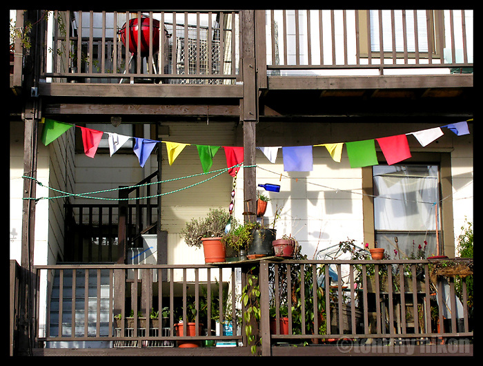 Mountain climber's prayer flags on outside deck.