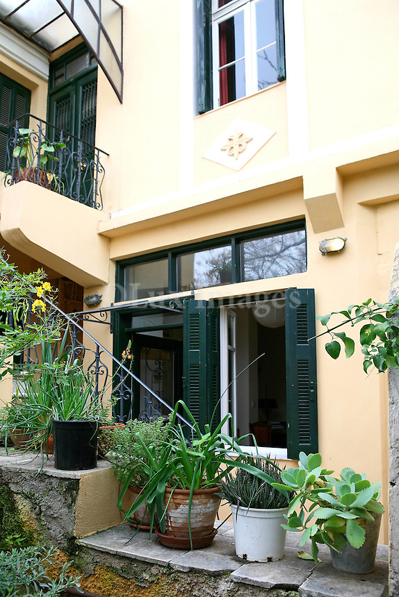The house is located in Plaka, the oldest area of Athens, Greece, and has a view of the Acropolis and Mt. Lycabettus.
