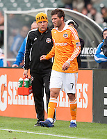 San Francisco, California - Saturday March 17, 2012: Colin Clark listens to Dynamo Trainer, Theron Enns during the MLS match at AT&T Park. Houston Dynamo defeated San Jose Earthquakes  1-0
