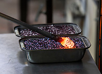 BNPS.co.uk (01202 558833)<br /> Pic:PhilYeomans/BNPS<br /> <br /> Molten silica is then dipped into various metal oxide's to create the colour designs - with no two being alike.<br /> <br /> I'm forever blowing Baubles...!<br /> <br /> Britain's biggest hand blown Christmas bauble factory is working flat out at this time of year to keep up with demand for the festive favourite.<br /> <br /> 10,000 baubles are blown and individually signed every year at Bath Aqua Glass using raw silica for the blue tinged glass that is then coated with a mixture of copper, iron, manganese or even gold oxide to create colourful and unique designs.<br /> <br /> Evidence of glass making dating back to Roman times have been discovered in the historic Somerset town and boss Annette Dolan keeps the tradition alive with the delicate creations being sent all over the world.