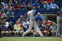 Johan Lopez (32) of the Charleston RiverDogs follows through on his swing against the Kannapolis Cannon Ballers at Atrium Health Ballpark on July 1, 2021 in Kannapolis, North Carolina. (Brian Westerholt/Four Seam Images)