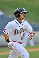 Third baseman Michael Chavis (11) of the Greenville Drive runs toward first in a game against the Rome Braves on Sunday, July 31, 2016, at Fluor Field at the West End in Greenville, South Carolina. Rome won, 6-3. (Tom Priddy/Four Seam Images)