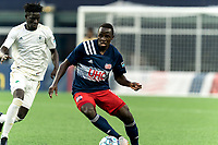 FOXBOROUGH, MA - AUGUST 5: Edward Kizza #19 of New England Revolution II dribbles during a game between North Carolina FC and New England Revolution II at Gillette Stadium on August 5, 2021 in Foxborough, Massachusetts.