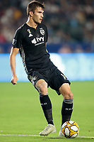 CARSON, CA - SEPTEMBER 15: Graham Smith #16 of Sporting Kansas City crosses a ball during a game between Sporting Kansas City and Los Angeles Galaxy at Dignity Health Sports Complex on September 15, 2019 in Carson, California.