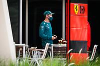 26th March 2021; Sakhir, Bahrain; F1 Grand Prix of Bahrain, Free Practice sessions;  VETTEL Sebastian (ger), Aston Martin F1 AMR21 saying hello to his former team Scuderia Ferrari during Formula 1 Gulf Air Bahrain Grand Prix 2021