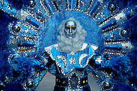 costume, masquerade, Philadelphia, parade, PA, Pennsylvania, A man in the Fancy Division is dressed in a blue costume of feathers wearing a silver mask in the Mummers Day Parade on New Years Day in Philadelphia.