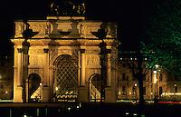 The Louvre Pyramid seen through the Arc de Triomphe du Carrousel at night, Paris, France.