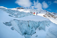 The Ortler Group in northern Italy is a popular region for spring ski touring using the huts for overnights to ski all the many peaks in the mountain group. Ski touring through a glacier's crevasses and seracs on the way to Punta Cadini.