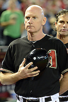 Arizona Diamondbacks coach Matt Williams (9) during the national anthem before a game against the Washington Nationals at Chase Field on September 28, 2013 in Phoenix, Arizona.  Washington defeated Arizona 2-0.  (Mike Janes/Four Seam Images)