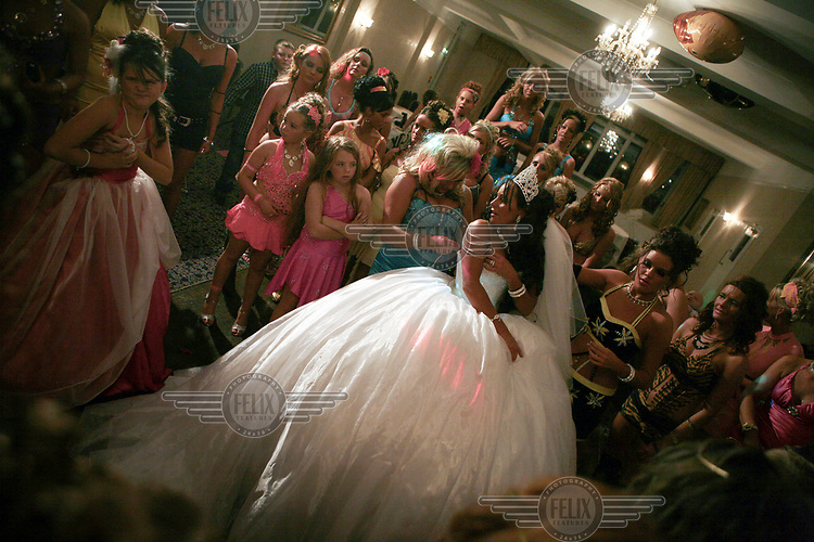 Irish Traveller Diane McCarthy prepares to dance her 'Waltz', where she says a tearful farewell to her maternal family and welcomes her new husband and his family, during the double wedding celebrations of Diane and MaryAnn McCarthy.
