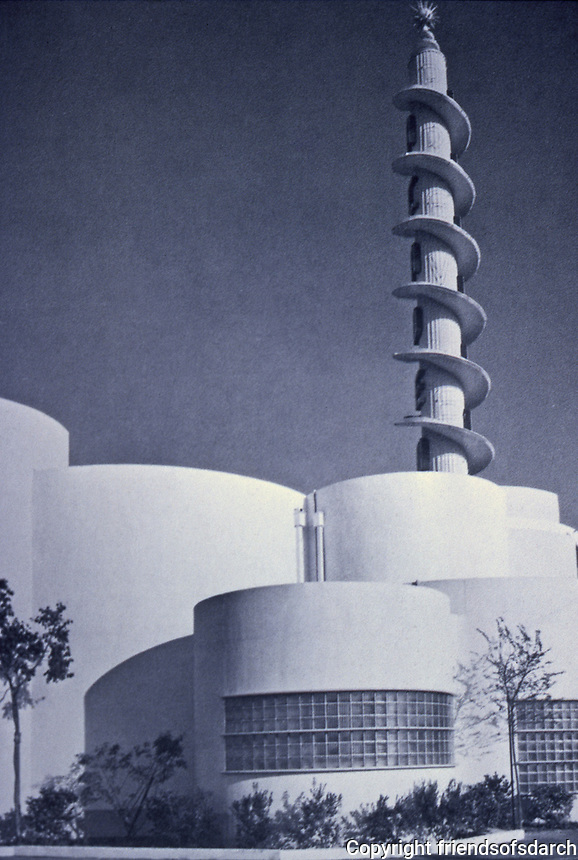 Academy Theater.  S. Charles Lee 1939.  The UCLA S. Charles Lee Archive notes that the inspiration for the tower was that of a spool of film unwinding. Streamline Moderne.<br />