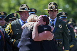 Carson City Sheriff's Deputy Carl Howell's wife Rachel, right, hugs an unidentified friend as her husband's casket arrives at a memorial service at the Reno Events Center in Reno, Nev., on Thursday, Aug. 20, 2015. Howell was shot and killed early Saturday morning after responding to a domestic violence call. (Cathleen Allison/Las Vegas Review-Journal)