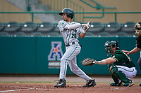 Dartmouth Big Green shortstop Bryce Daniel (20) bats in front of catcher Tyler Dietrich (38) and home plate umpire Rick Darby during a game against the USF Bulls on March 17, 2019 at USF Baseball Stadium in Tampa, Florida.  USF defeated Dartmouth 4-1.  (Mike Janes/Four Seam Images)