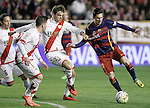 Rayo Vallecano's Adrian Embarba (l) and Diego LLorente (c) and FC Barcelona's Leo Messi during La Liga match. March 3,2016. (ALTERPHOTOS/Acero)