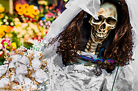 A statue of Santa Muerte (Saint Death), clothed in a wedding dress, is seen placed outside the shrine in Tepito, a dangerous neighborhood of Mexico City, Mexico, 1 May 2011. The religious cult of Santa Muerte is a syncretic fusion of Aztec death worship rituals and Catholic beliefs. Born in lower-class neighborhoods of Mexico City, it has always been closely associated with crime. In the past decades, original Santa Muerte's followers (such as prostitutes, pickpockets and street drug traffickers) have merged with thousands of ordinary Mexican Catholics. The Saint Death veneration, offering a spiritual way out of hardship in the modern society, has rapidly expanded. Although the Catholic Church considers the Santa Muerte's followers as devil worshippers, on the first day of every month, crowds of believers in Saint Death fill the streets of Tepito. Holding skeletal figurines of Holy Death clothed in a long robe, they pray for power healing, protection and favors and make petitions to 'La Santísima Muerte', who reputedly can make life-saving miracles.