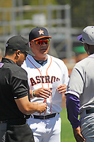 Buies Creek Astros manager Omar Lopez (22) meeting at home plate before a game against the Winston-Salem Dash at Jim Perry Stadium on the campus of Campbell University on April 9, 2017 in Buies Creek, North Carolina. Buies Creek defeated Winston-Salem 2-0. (Robert Gurganus/Four Seam Images)