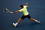 BANGKOK, THAILAND - OCTOBER 01:  Rafael Nadal of Spain returns a ball to Mikhail Kukushkin of Kazakhstan during the Day 7 of the PTT Thailand Open at Impact Arena on October 1, 2010 in Bangkok, Thailand. Photo by Victor Fraile / The Power of Sport Images