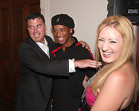 Kris Kelderman of DC United tries to arrange a pose with Ronaldinho of AC Milan at a reception for AC Milan at DAR Constitution Hall in Washington DC on May 24 2010.
