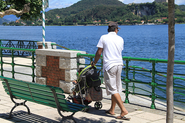 Father and baby stroller along Lake Maggiore, Arona, Italy,