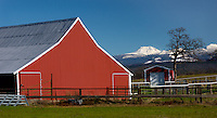 The peak of a barn mimics the distant Mount Shasta in California.