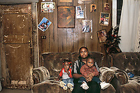 Mississippi Delta. Woman raising her children alone as her husband is institutionalized.