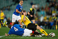 SYDNEY, AUSTRALIA - JULY 31, 2010: Makos Grigoris of AEK Athens is tackled by Kirk Broadfoot or Rangers during the match between AEK Athens FC and Glasgow Rangers at the 2010 Sydney Festival of Football held at the Sydney Football Stadium on July 31, 2010 in Sydney, Australia. (Photo by Sydney Low / www.syd-low.com)