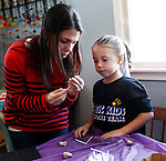 Newtown, CT- 27 December 2013-122813CM04-  Liz Alagno, and her daughter Lauryn, 5, of Oxford mold a bead with  clay during a Ben's Bells Project workshop in Newtown Saturday.  Volunteers make the long strands of bells and distribute them to communities in an effort to advocate kindness and healing.    Christopher Massa Republican-American