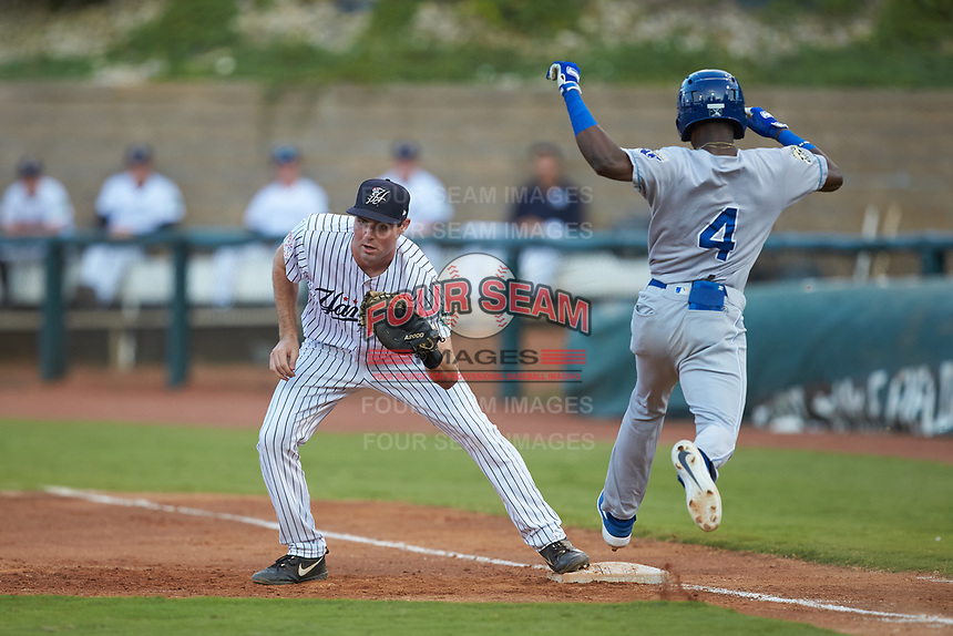 Pulaski Yankees first baseman Jake Farrell (72) fields a throw as Diego Hernandez (4) of the Burlington Royals hustles down the line at Calfee Park on September 1, 2019 in Pulaski, Virginia. The Royals defeated the Yankees 5-4 in 17 innings. (Brian Westerholt/Four Seam Images)