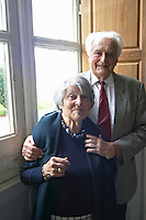 Jean Perromat and his wife by a window in the chateau Chateau de Cerons (Cérons) Sauternes Gironde Aquitaine France