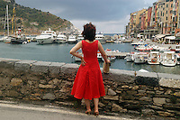 - general sight of the village and tourist port, woman with red dress....- panoramica del paese e porto turistico, donna con vestito rosso