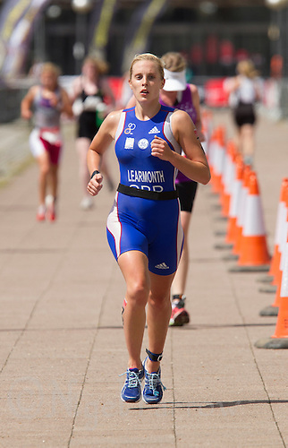 28 JUL 2013 - LONDON, GBR - Jess Learmonth makes her way to the turn by Building 1000 during the run for the elite women's race at the 2013 Virgin Active London Triathlon in Excel, Royal Victoria Dock, London, Great Britain (PHOTO COPYRIGHT © 2013 NIGEL FARROW, ALL RIGHTS RESERVED)