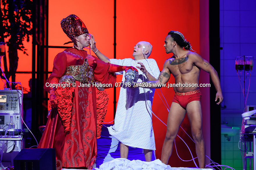 """EMBARGOED UNTIL 23:00 FRIDAY 18 OCTOBER 2019: London, UK. 16.10.2019.  English National Opera presents """"The Mask of Orpheus"""", by Sir Harrison Birthwhistle, libretto by Peter Zinovieff, at the London Coliseum, in its first London restaging in the 30 years since its premiere, coinciding with the celebration of Sir Harrison's 85th birthday. Directed by Daniel Kramer, with lighting design by Peter Mumford, set design by Lizzie Clachan and costume design by Daniel Lismore. Picture shows: Daniel Norman (Orpheus the Myth), Peeter Hoare (Orpheus the Man), Matthew Smith (Orpheus the Hero).  Photograph © Jane Hobson."""