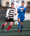Shire's Graeme McGregor and Montrose's Terry Masson challenge for the ball.