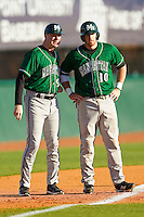 Manhattan Jaspers head coach Jim Duffy #9 talks to base runner Kyle Murphy #10 at third base during the game against the High Point Panthers at Willard Stadium on March 9, 2012 in High Point, North Carolina.  The Panthers defeated the Jaspers 11-6.  (Brian Westerholt/Four Seam Images)