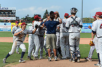 Mahoning Valley Scrappers players and staff including Josh McAdams (7), Martin Cervenka (20) celebrate on the mound after completing a no -hitter against the Batavia Muckdogs on September 1, 2013 at Dwyer Stadium in Batavia, New York.  The Mahoning Valley Scrappers pitching duo of Luis Gomez, Carlos Melo, and Kerry Doane tossed a no-hitter 6-0 victory over Batavia.  (Mike Janes/Four Seam Images)