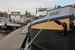 Boats moored at Oosterdok,along the Het Ij (Ij River) Amsterdam, Netherlands