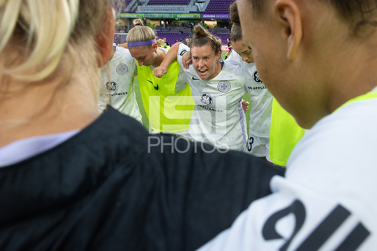 ORLANDO, FL - SEPTEMBER 11: Savannah McCaskill #7 of Racing Louisville FC getting her teammates going in the huddle before a game between Racing Louisville FC and Orlando Pride at Exploria Stadium on September 11, 2021 in Orlando, Florida.