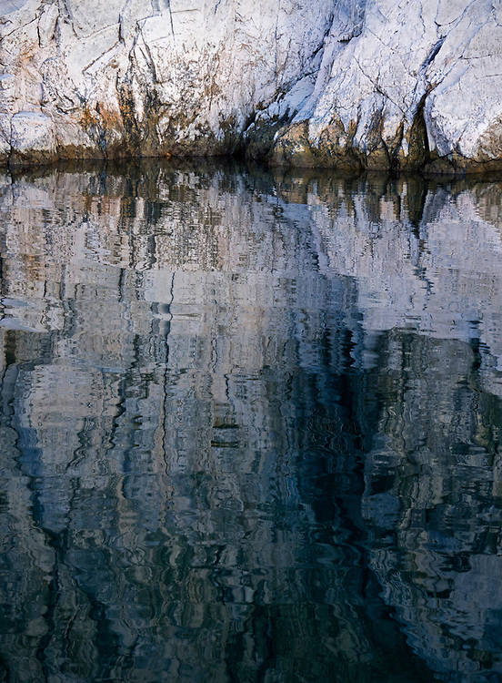 Abstract patterns and water reflections from the Bathtub Ring, a mineral deposit left at higher water flows through Lake Mead in the Lake Mead National Recreation Area on the Arizona-Nevada border (Photo from Arizona)