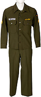 BNPS.co.uk (01202 558833)<br /> Pic: HA.com/BNPS<br /> <br /> Elvis Presley's personalised army suit has sold at auction for £15,000.<br /> <br /> The King of Rock 'n' Roll wore the khaki green jacket and trousers while serving in the US military between 1958 and 1960.<br /> <br /> Presley has been sewn into his top above his right-hand breast pocket, with a US Army badge above the left breast.