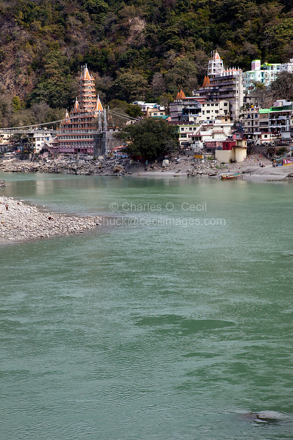 India, Rishikesh, and the River Ganges (Ganga).  The tall building on the left is the Tera Manzil Hindu Temple, holding numerous shrines to various Hindu gods.