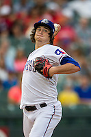 Round Rock Express pitcher Luke Jackson (27) makes a pickoff throw to first base during the Pacific Coast League baseball game against the Oklahoma City RedHawks on August 1, 2014 at the Dell Diamond in Round Rock, Texas. The Express defeated the RedHawks 6-5. (Andrew Woolley/Four Seam Images)