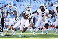 CHAPEL HILL, NC - NOVEMBER 14: Javonte Williams #25 of North Carolina runs for a touchdown during a game between Wake Forest and North Carolina at Kenan Memorial Stadium on November 14, 2020 in Chapel Hill, North Carolina.