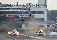 Sep 28, 2019; Madison, IL, USA; NHRA funny car driver Tim Wilkerson explodes the engine of his car on fire and blows the body off alongside Bob Bode during qualifying for the Midwest Nationals at World Wide Technology Raceway. Wilkerson would be uninjured in the incident. Mandatory Credit: Mark J. Rebilas-USA TODAY Sports
